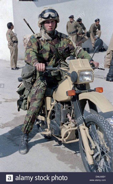 a-british-army-soldier-on-a-motorcycle-during-the-persian-gulf-war-DWJWBY.jpeg